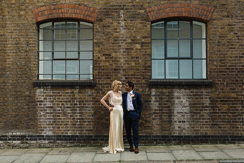Glamorous Bride in Catherine Deane Zaden Wedding Dress & Groom in Banana Republic Suit - Paul Joseph Photography | Catherine Deane Zaden Wedding Dress from BHLDN | Glamorous 06 St Chad's Place London Wedding | Bright Flowers