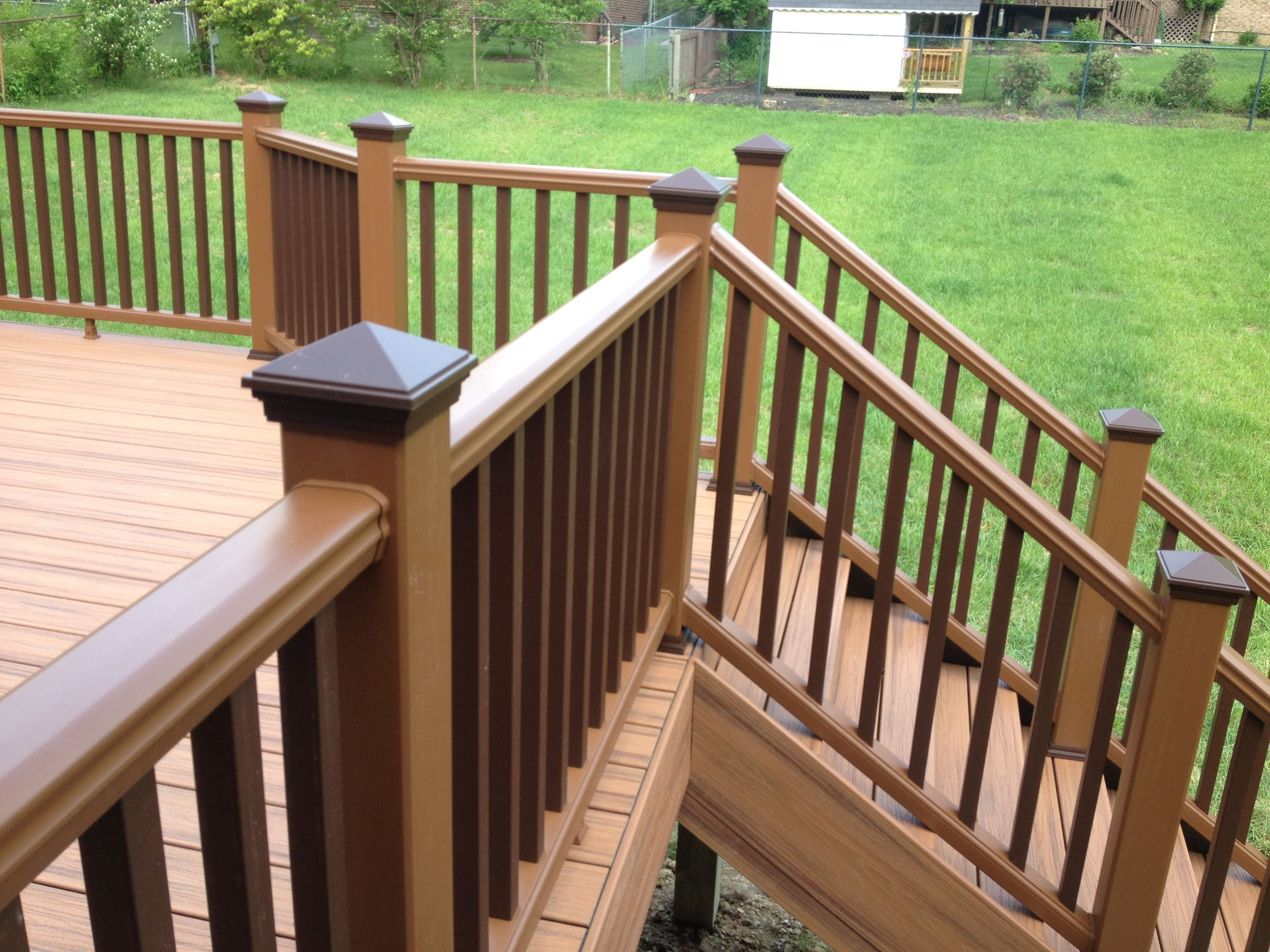Transcends rail in treehouse with vintage lantern accents for Composite decking and railing