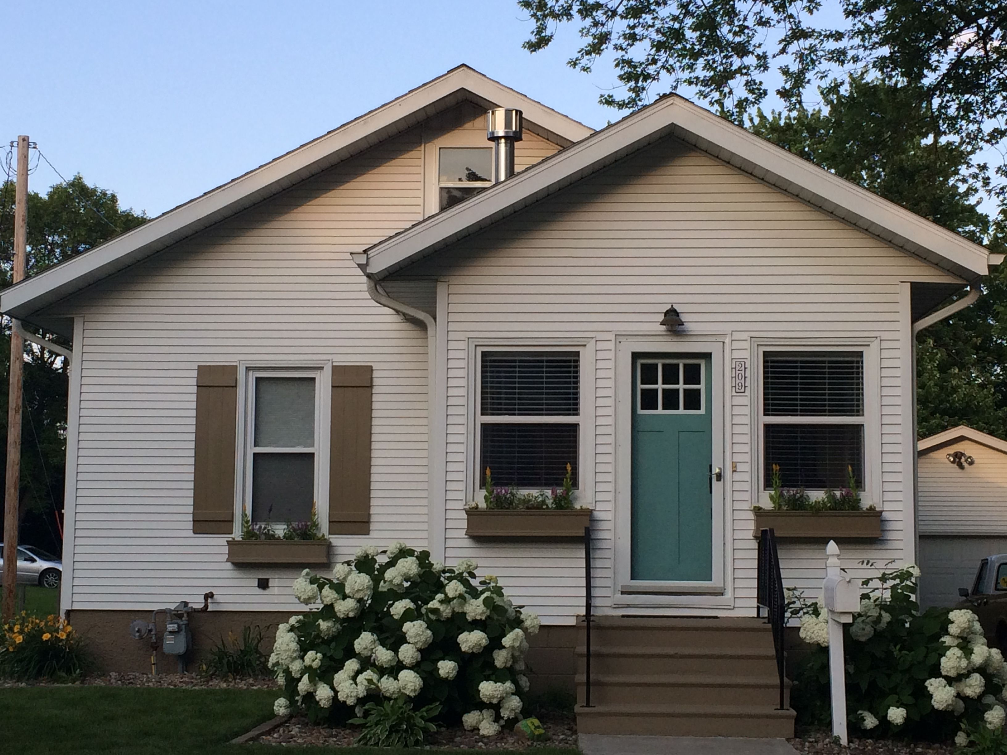 Exterior house colors cottage - Just Gave My House A Facelift Door Paint Color Drizzle By Sherwin Williams Window