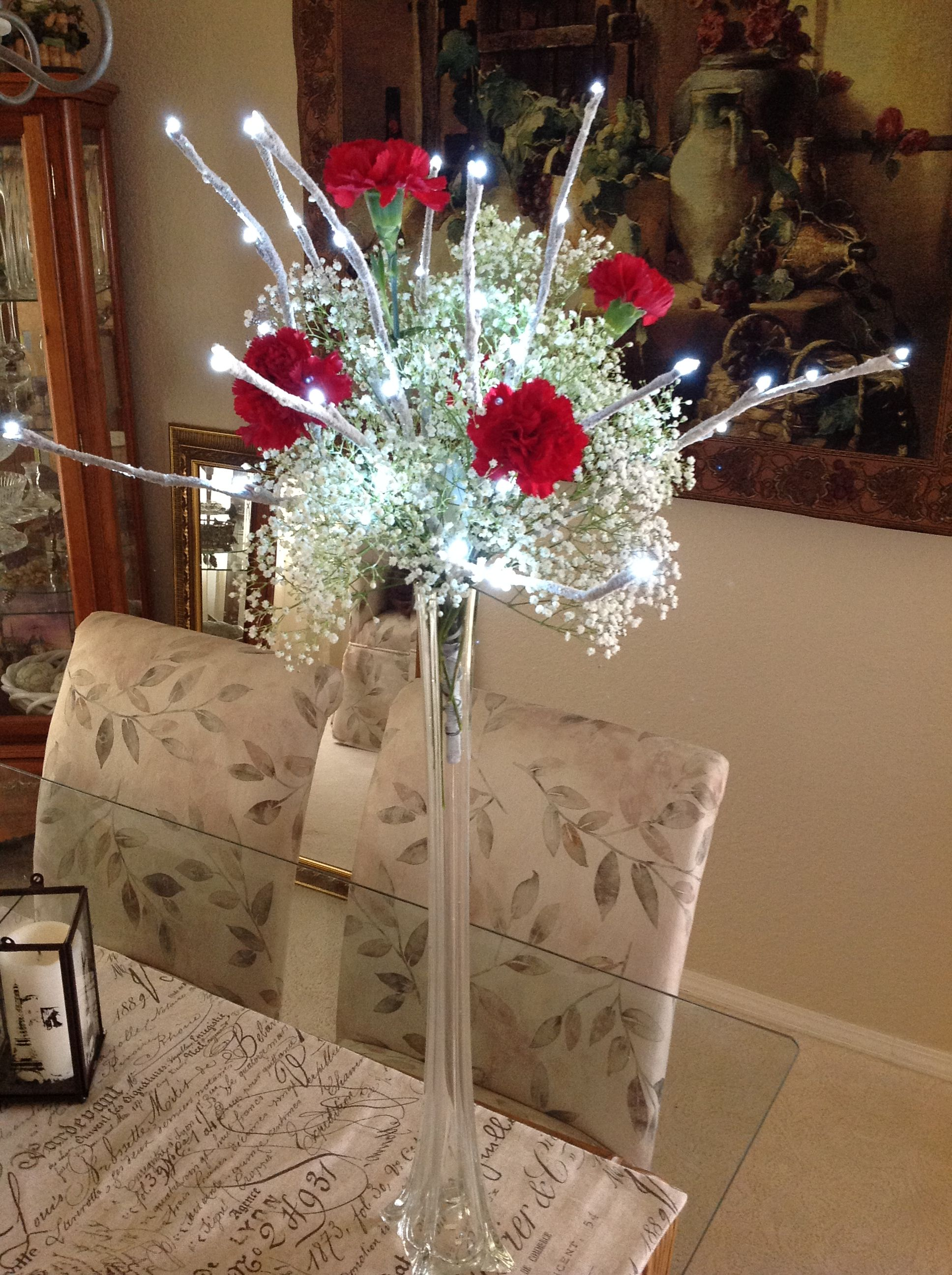 Lighted branch arrangements in eiffel tower vases for Table arrangements