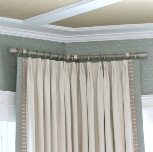Drapery Panels Hang From Grommets On A Custom Curved Iron Rod