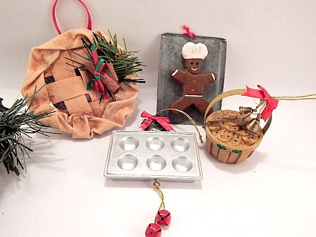 "Set of four (4) Christmas tree ornaments One (1) Cinnamon potpourri scented pie - fabric crust, aluminum pan, cinnamon stick and greenery 3 1/2"" diameter x 1 1/3"" h, with 2"" red ribbon hanging loop One (1) Resin basket with metal handle appears filled ..."