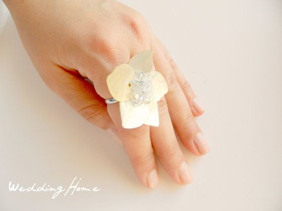 Hey, I found this really awesome Etsy listing at http://www.etsy.com/listing/104501598/shell-ring-bride-bridal-accessory