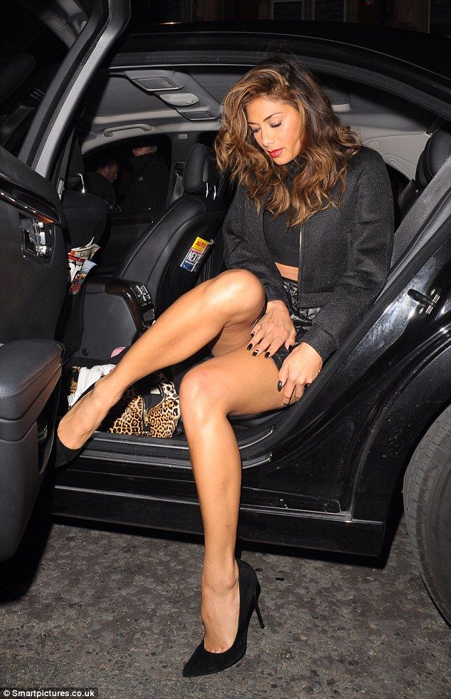 Stunning Nicole Teamed The Mini Skirt With A Crop Top And A Bomber Jacket