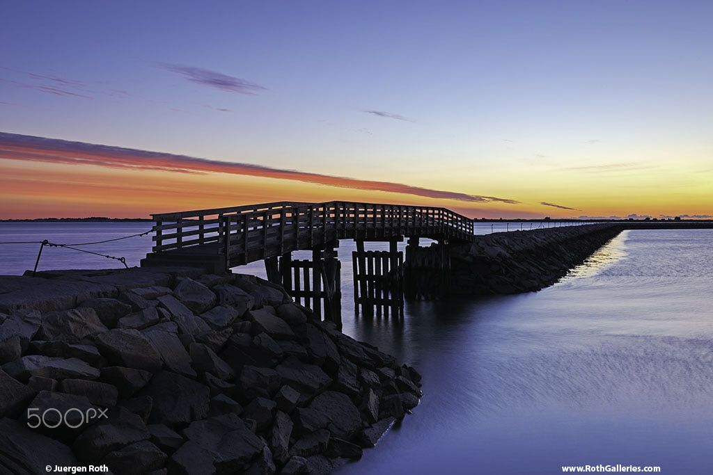 Seascape photography of the harbor jetty with its wooden bridge at - k chenr ckwand nach ma