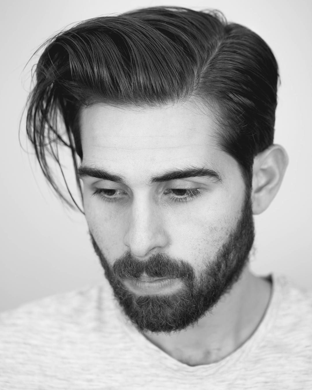A Long Side Part Hairstyle With A Taper Haircut After 9 Months Of Growing Hair Out For Men Longh Growing Your Hair Out Long Hair Styles Men Growing Out Hair