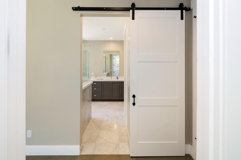 Open Sliding Barn Door Giving A Peek Of The Bathroom Interior Top Bathroom Design Door Alternatives Bathroom Doors