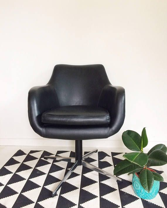 This stunning black swivel chair is in black vinyl with a chrome base. It would look stylish in a living room, dining room, bedroom or office. Measurements; H 76cm Seat height 49cm D 49cm W 62cm  This is a vintage piece that has been used and loved, which adds to its charm. There may be imperfections in keeping with its age, although we always try to give an honest description of anything we feel is beyond normal wear and tear. Please ensure that you are happy with the item before buying as…