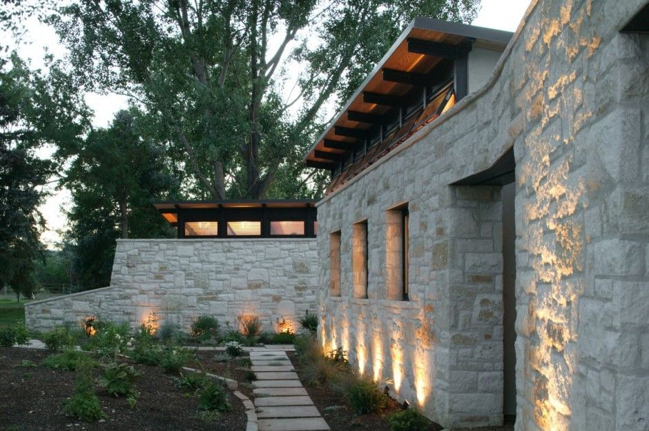 Love the stone and wood clerestory windows roof line Again