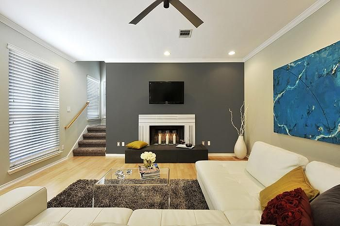 Love this Blue Painting with the Gray wall and White Leather Couch.