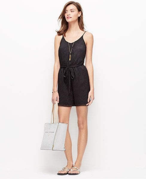 Detailed with textured dot detail, this one-piece wonder is a sizzling warm weather staple. Scoop neck. Adjustable spaghetti straps. Self tie belt. Front off-seam pockets.