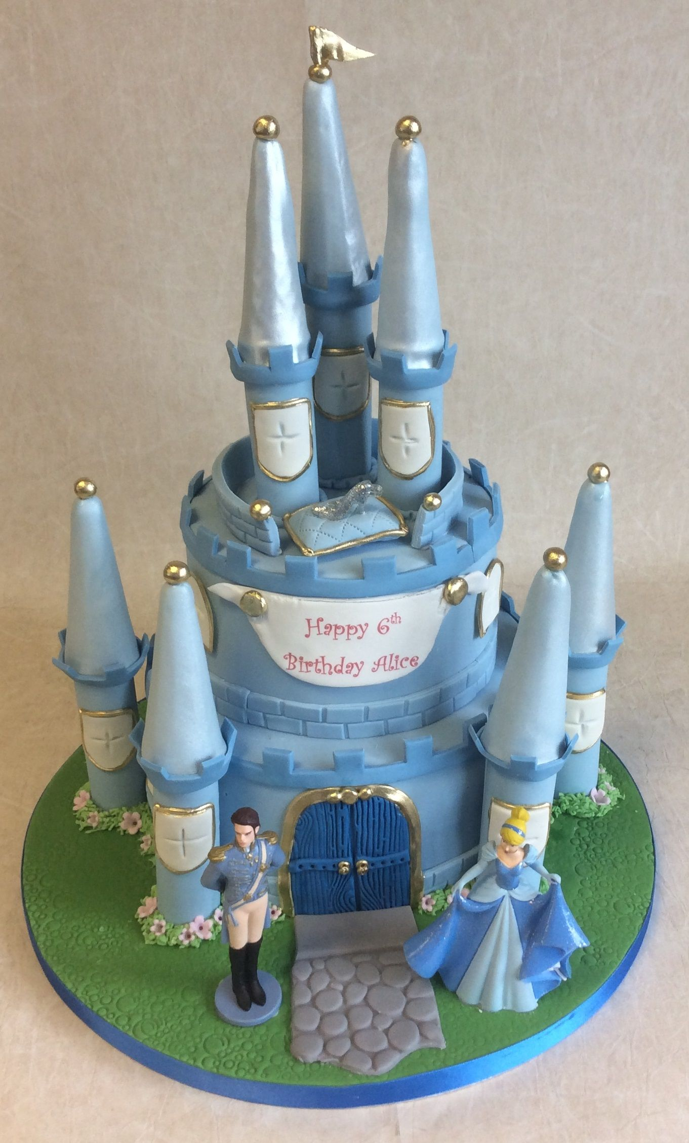2 tier cinderella castle cake including non-edible figures of