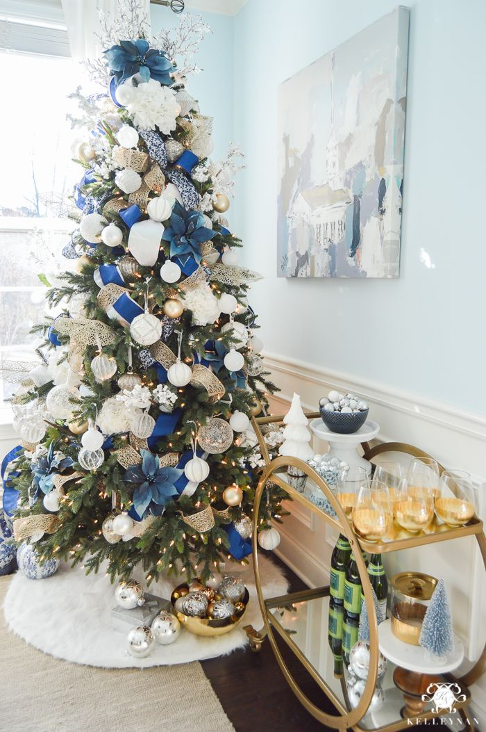 blue and white christmas tree with bar cart in dining room