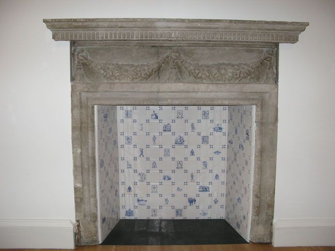 i love the stone mantel surround with the delft tiles inside the fireplace fireplaces