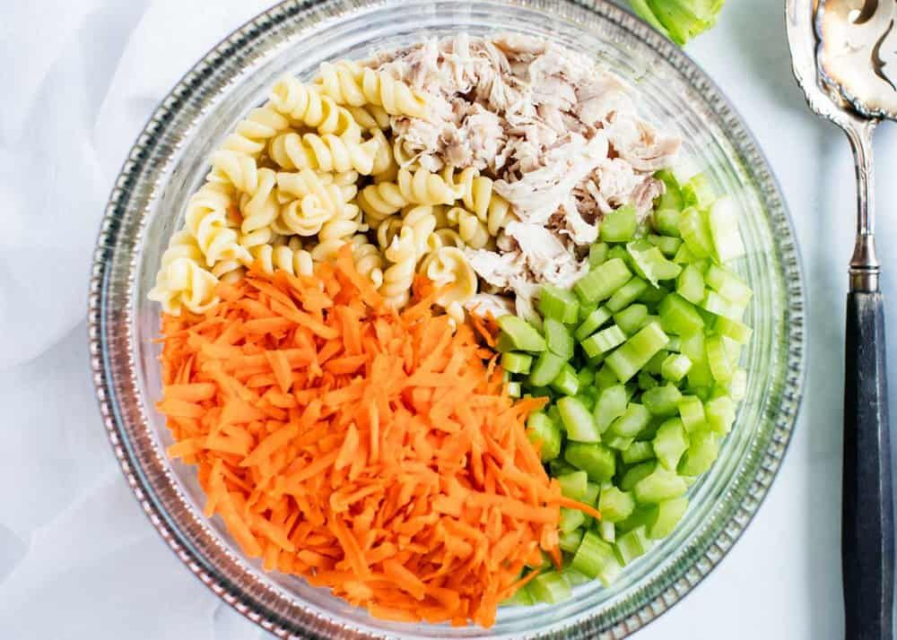 Buffalo Chicken Pasta Salad This buffalo chicken pasta salad has the perfect combination of noodles, crisp veggies, tangy buffalo chicken and a cooling ranch sauce. Topped with creamy blue cheese for an easy summer pasta salad the entire family will love!