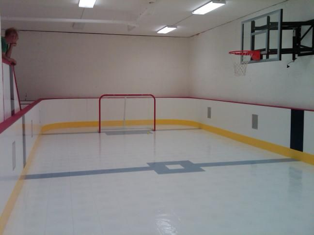 Hockey room and sport court for the kiddos someday for Basement sport court