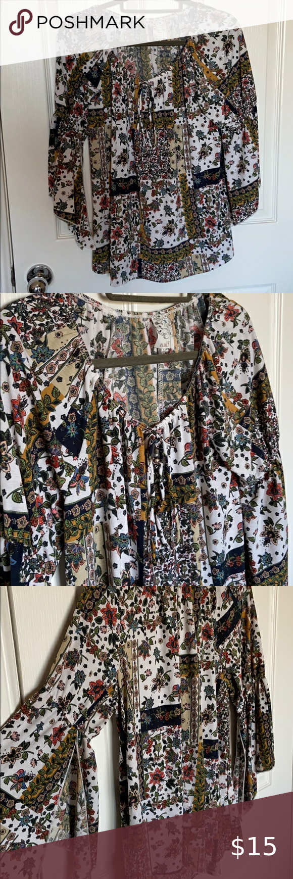 Floral Bell-Sleeved Blouse Boho! Hello! This blouse is casual and chic, with a tassel-tie around the neck and dreamy bell sleeves add movement. Quinte…