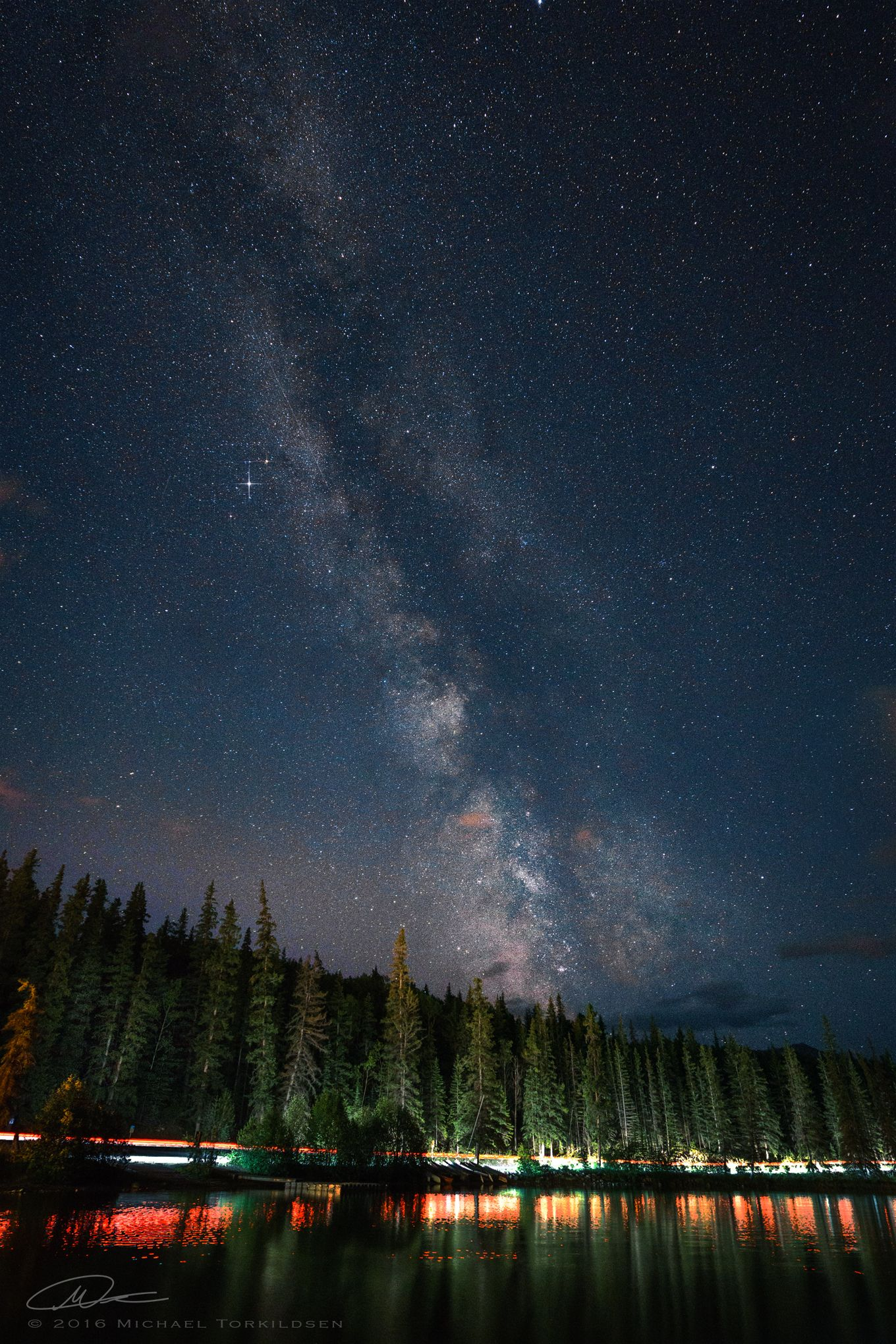 Under the Milky Way a car lights up the pine forest of Pyramid Lake Alberta Canada. [OC] [2040x1360] http://ift.tt/2enzZbR