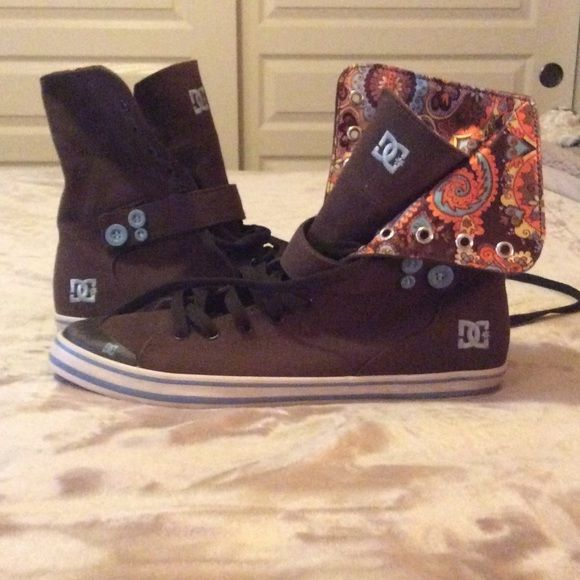 DC High Tops Size 10W w/ paisley print Size 10w DC High tops featuring a retro paisley print. Chocolate colored outer with paisley print on the inside. Print is chocolate, orange, blue and yellow with a flower/heart motif. Full lace ups with a Velcro strap. Powder blue button accents. Great condition, some very slight scuff marks on toe, otherwise looks new! DC Shoes Sneakers