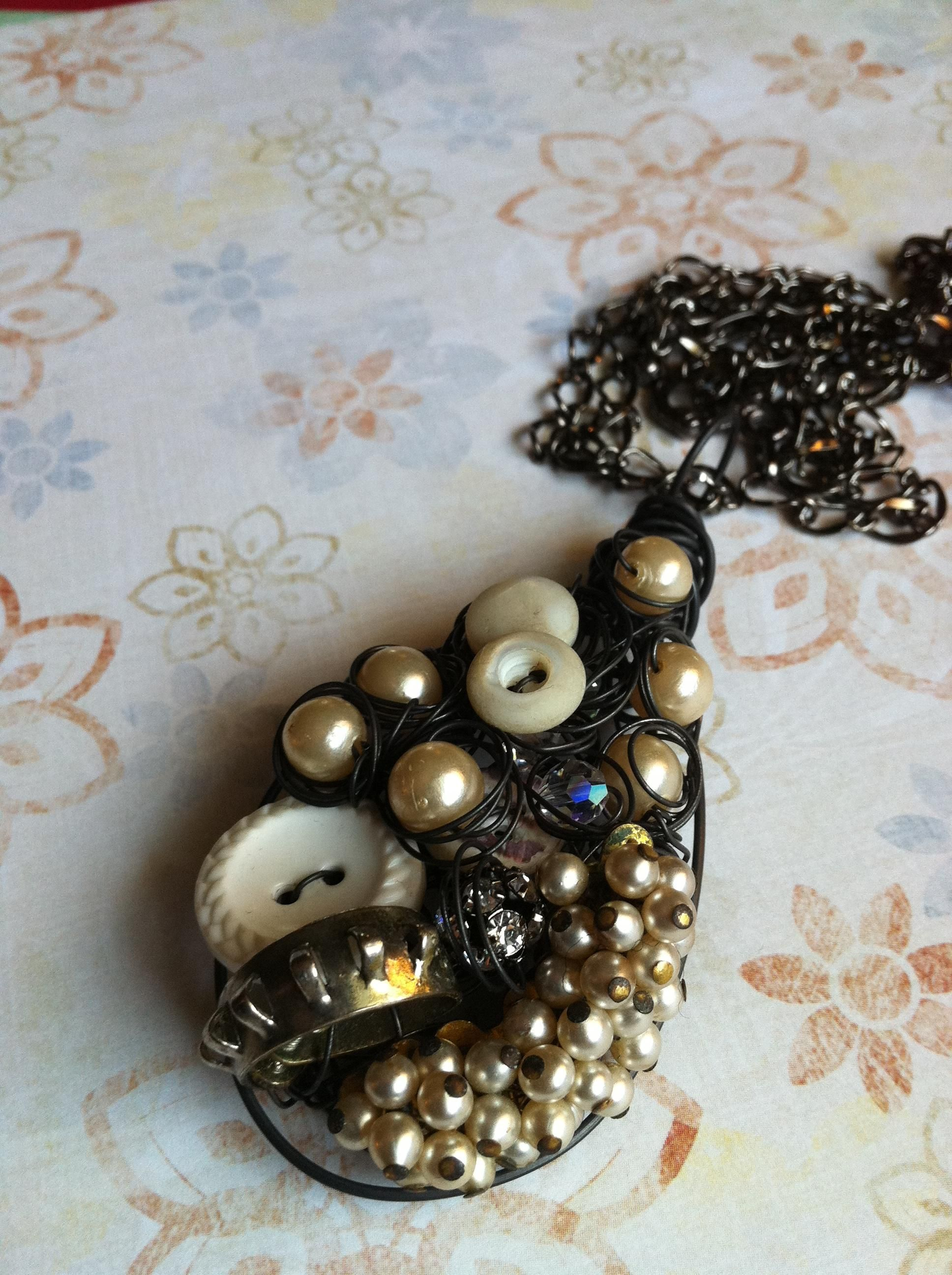 A multimedia pendant created with vintage elements for new trendy pleasure!