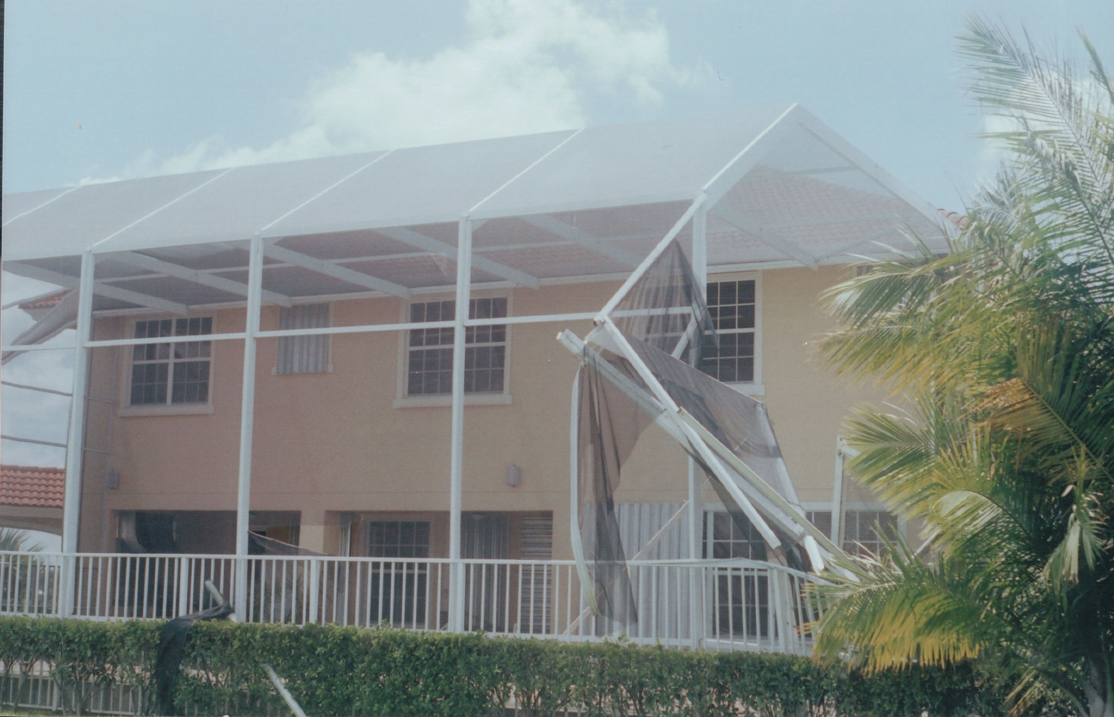 The Whole Side Of This 2 Story Screen Enclosure Was Blown In By The Storm Screen Enclosures Pool Screen Enclosure Swimming Pools