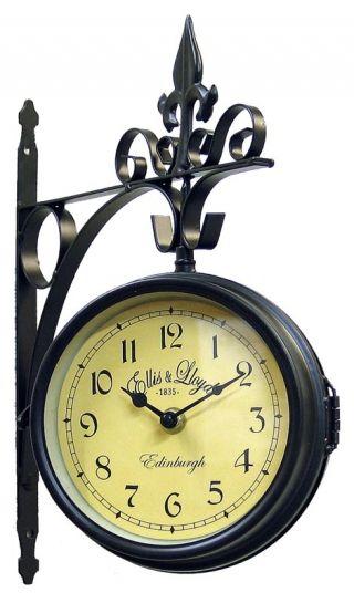 """Ceas de gara """"Ellis & Lloyd"""" - ceas vintage de perete având carcasa din metal şi cadran dublu. Cele două cadrane pot fi setate individual (poate doriţi ca fiecare să arate un alt timp!) şi se prind lateral printr-o cheiţă."""