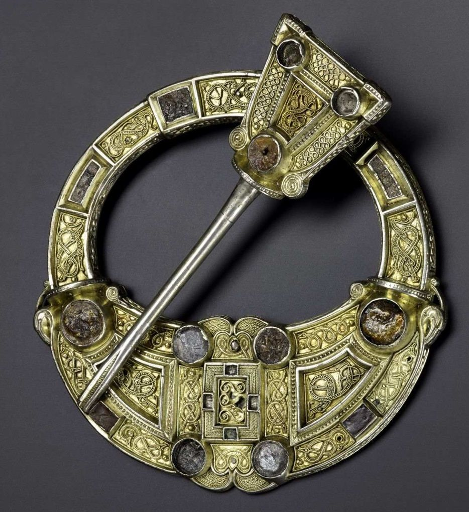An ornate silver, gold and amber brooch found in Hunterston, Scotland, from 700-800AD. Photograph: National Museums Scotland.