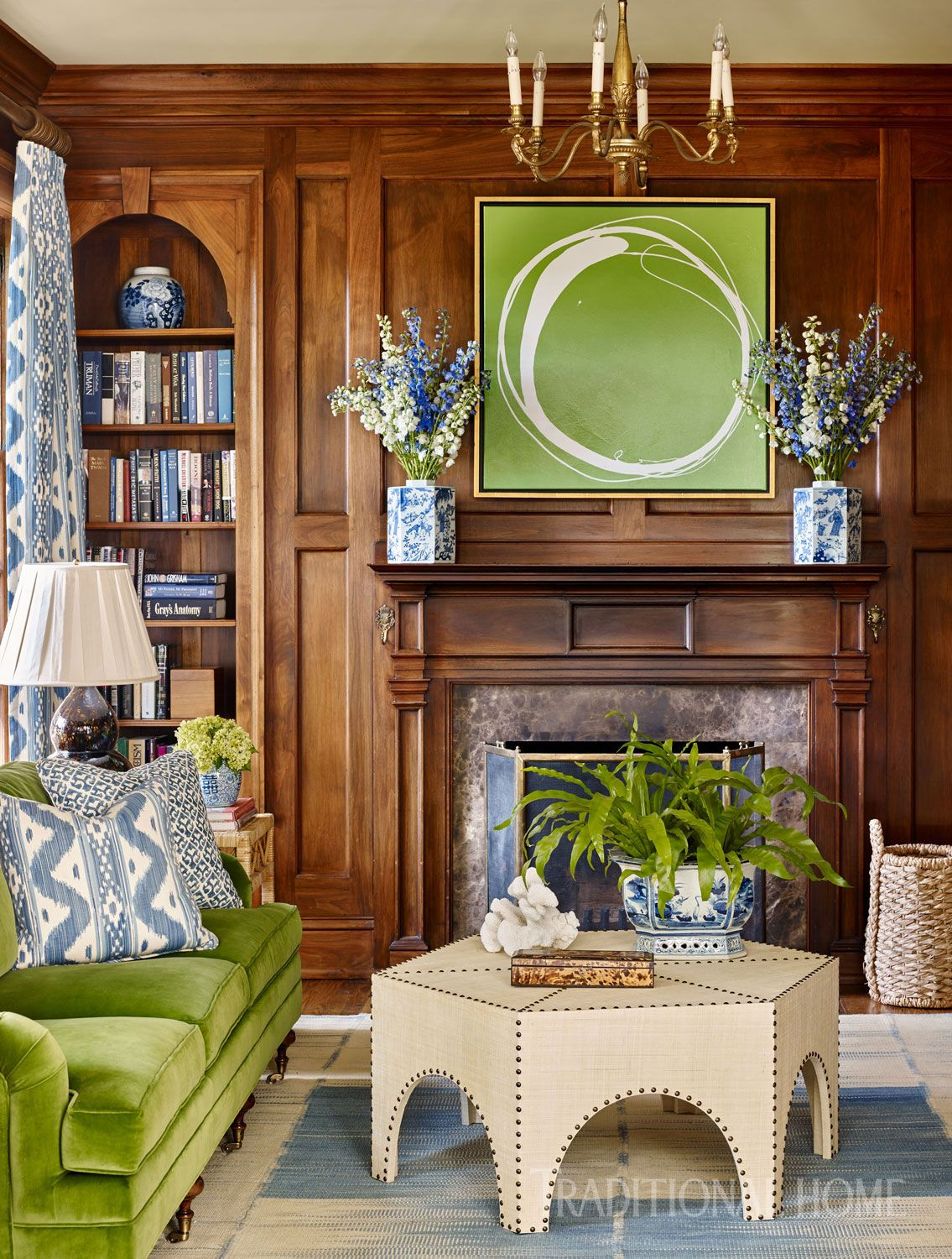 Fresh greens in art and upholstery bring energy to the husbands favorite retreat photo