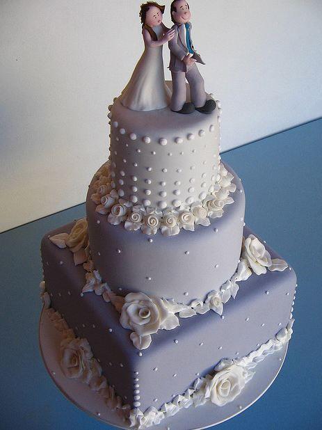 Tri Tier Lavender Wedding Cake With White Floral Desgin And Bride Groom Topper