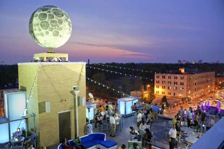 Tails On The Roof Under World S Largest Manmade Moon Moonrise Hotel St