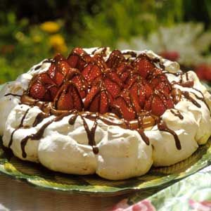 berries in a cloud          This heavenly dessert recipe is mounds of meringue filled with creamy cocoa mousse, crowned with sweet ripe whole strawberries, and drizzled with chocolate.
