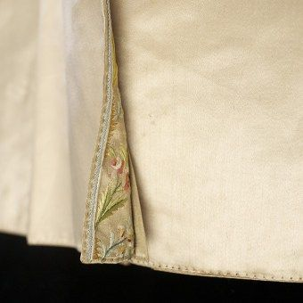 Interior of coat tails showing peek of embroidery, KSUM 1983.1.22.