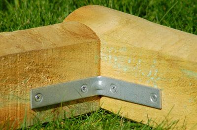 finish off flower beds in style with landscape timber edging diy