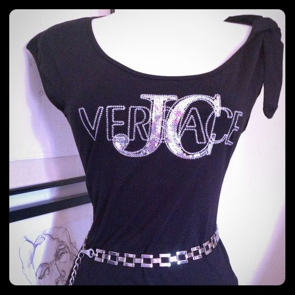 Versace Jeans Couture Sequin Tee w/ Keyhole Back HOT! Versace Jeans Couture Sequin Tee w/ Keyhole Back and signature button. Features convertible shoulder sleeve tie (see pics). Super soft and super blingy! Looks so fab under a white pant suit or over khaki silk shorts and strappy sandals!  Size Medium. Tops