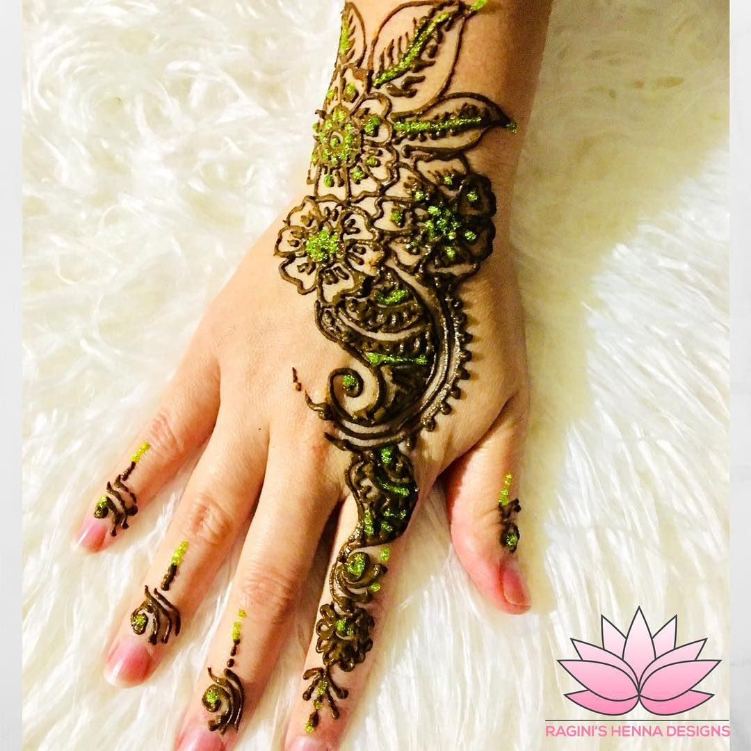 Simple floral and green glitter henna design during the