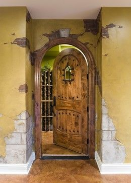 Wine Cellar Entry Done With A Faux Finish Resembling Crumbling Stucco And Exposed Stone The Door Faux Brick Walls Wine Cellar Design Beautiful Houses Interior