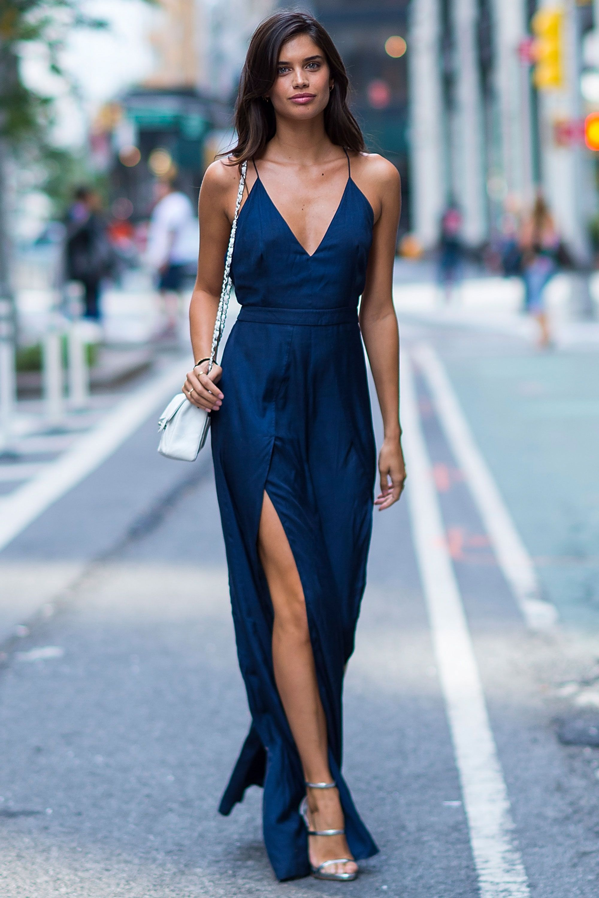 e576898bc04 Sara Sampaio looked chic in a simple navy floor-length jumpsuit with split  legs.