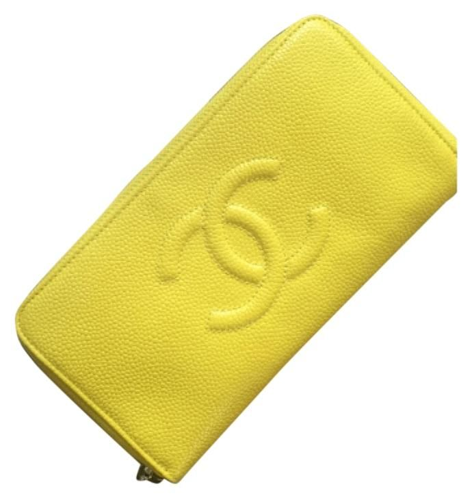 e9590c2f617c Free shipping and guaranteed authenticity on Chanel NWT YELLOW CAVIAR L- Zip  Gusset Wallet at Tradesy. Just Like New and 100% Authentic Chanel L- ...