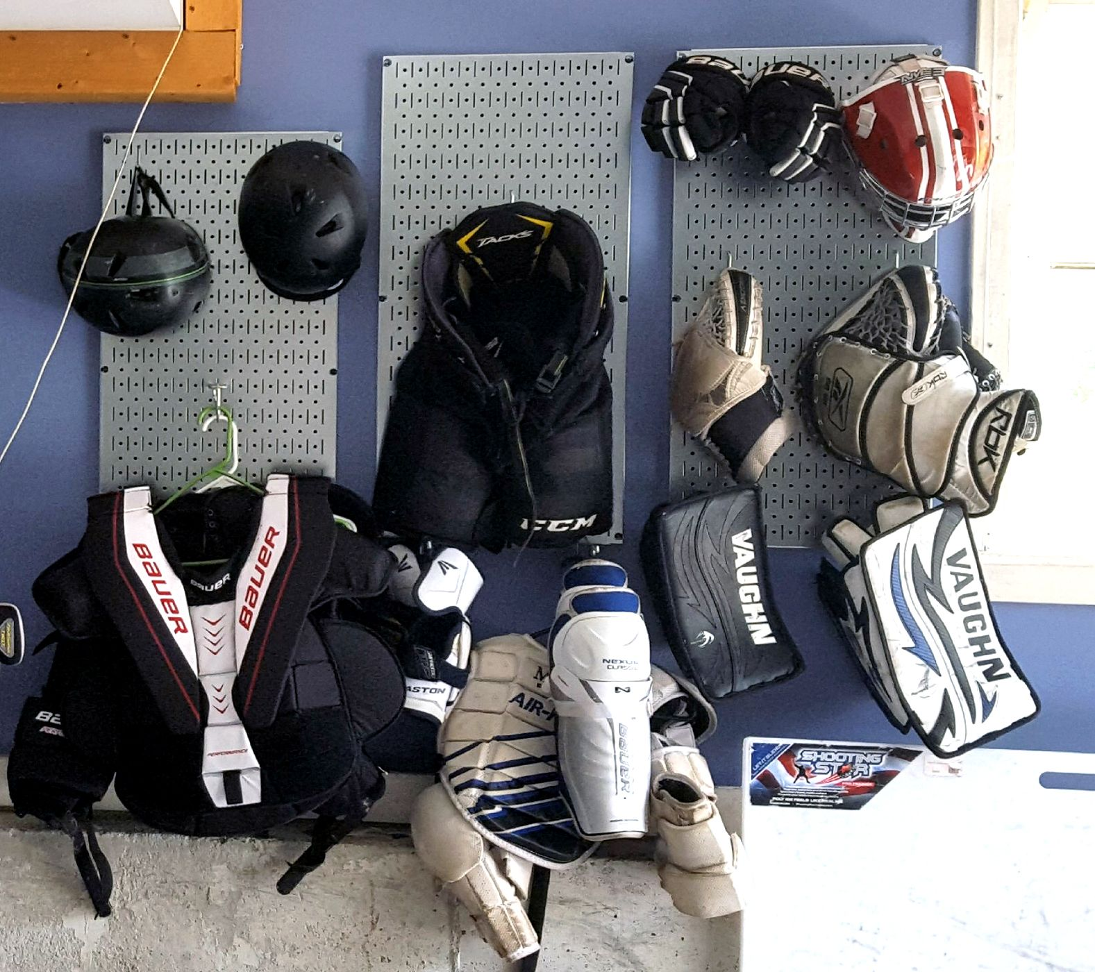 use wall control pegboard to organize lacrosse equipment on wall control id=57160