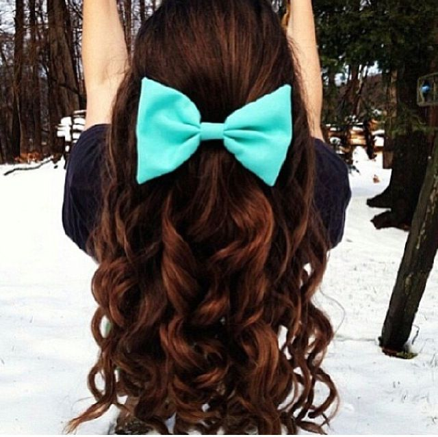 Brown long curly hair with bow