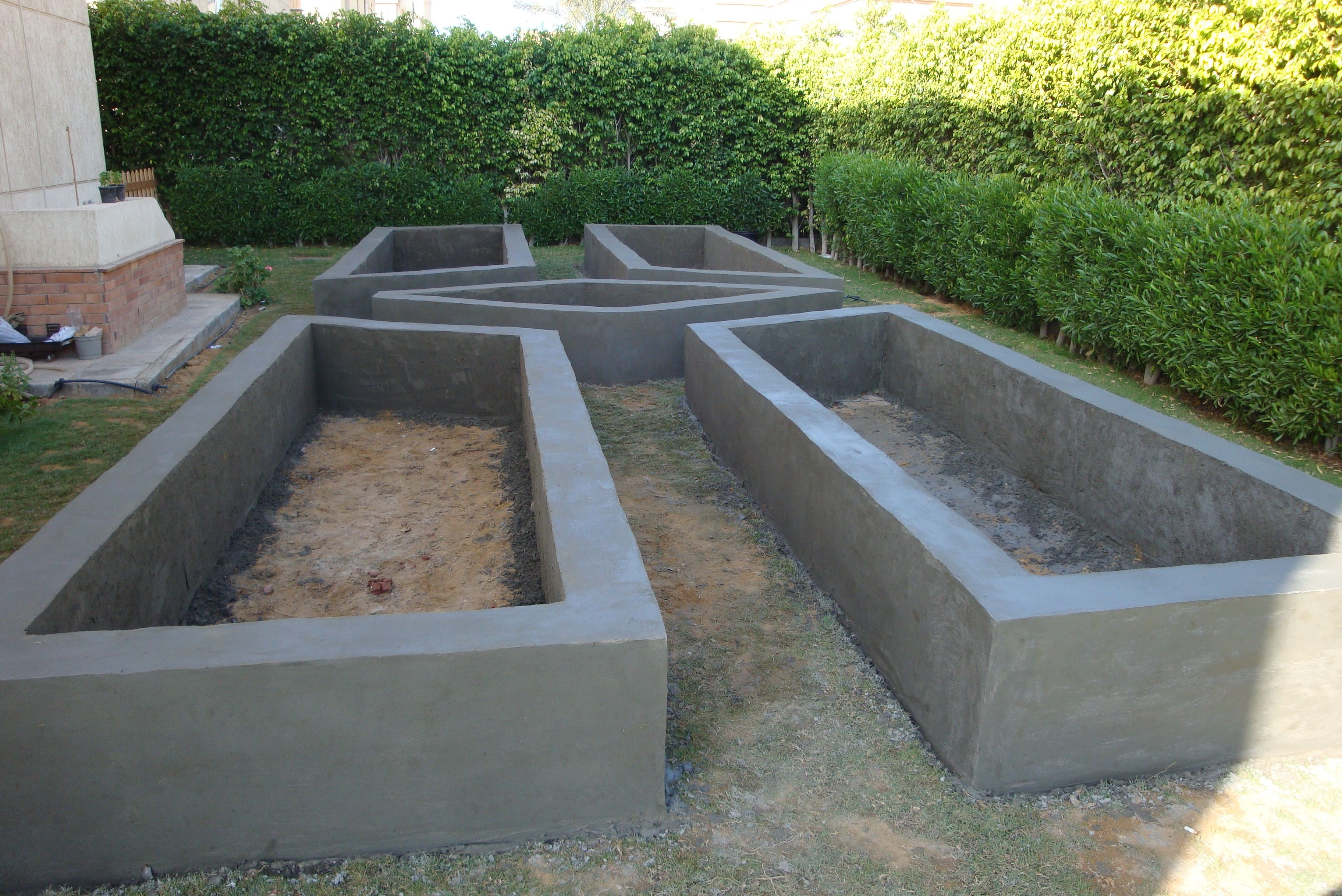 Raised Garden Bed made of block and covered with concrete. http