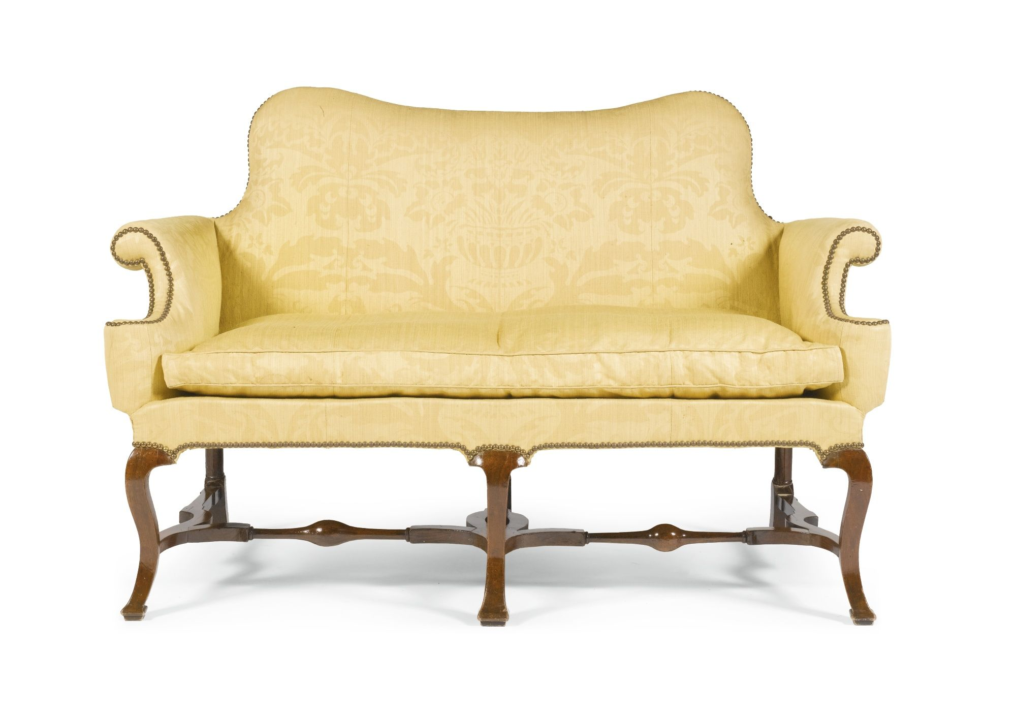 A Queen Anne Walnut Sofa Circa 1710 The Shaped Back With Outscrolled Arm Supports On Cabriole