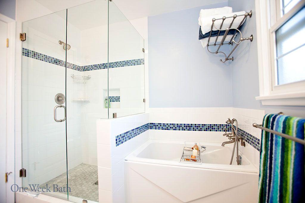 A walk in, glass door shower alongside a separate step in bathtub ...