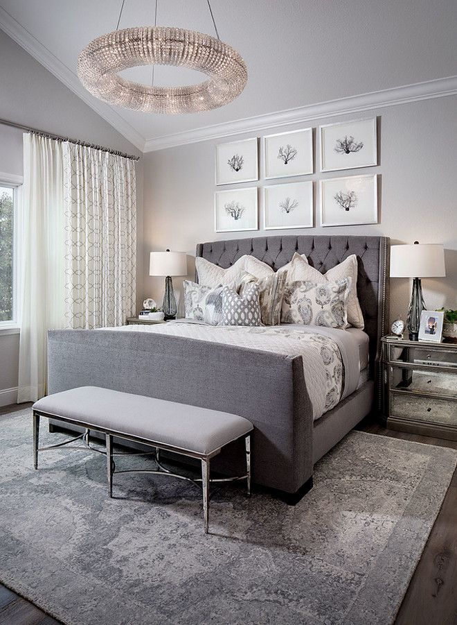 Grey Tufted Master Bedroom Bed With Six Picture Frames Above It