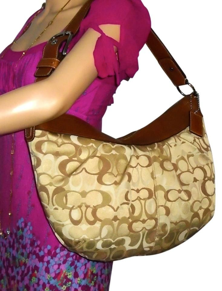 e8ef3b7c12b4 Coach Soho Optic Signature Hobo Bag. Hobo bags are hot this season! The  Coach Soho Optic Signature Hobo Bag is a top 10 member favorite on Tradesy.