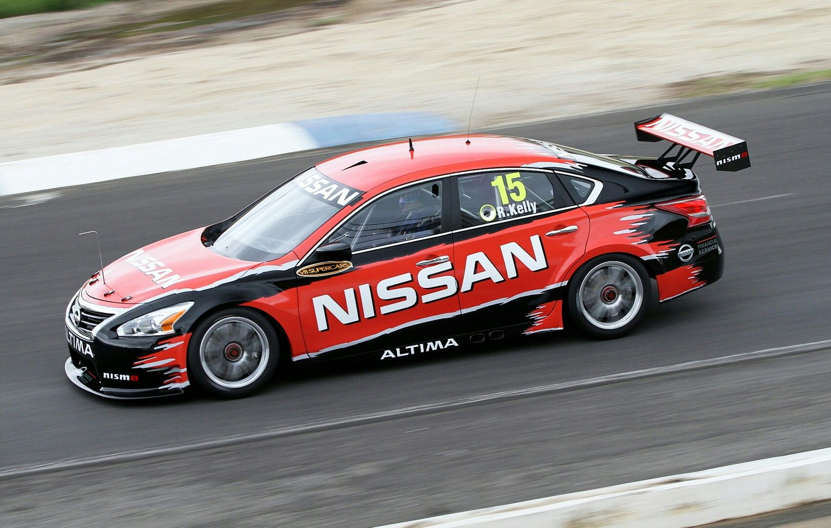 v8 supercar on melbourne track todd kelly takes nissan altima on track for its first shakedown