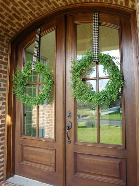 Hang Wreath With Ribbon Stapled To Top Of Door...wondering If We Can Just  Use Duct Tape Seeing As Its A Rental