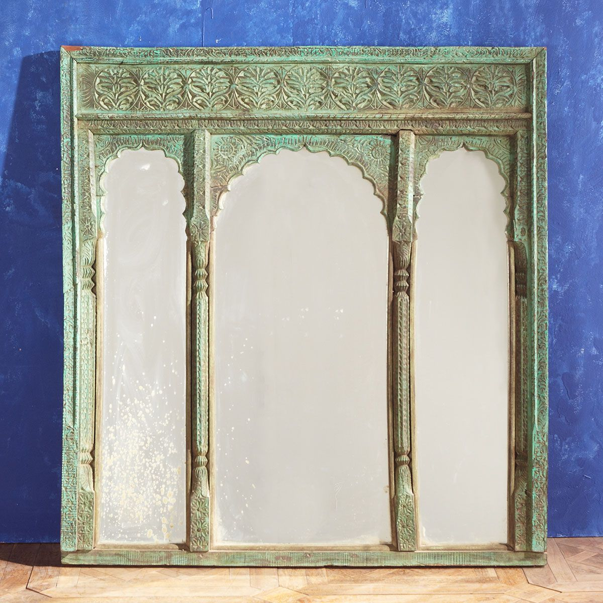 Arched Indian wood window frames turned into a mirror