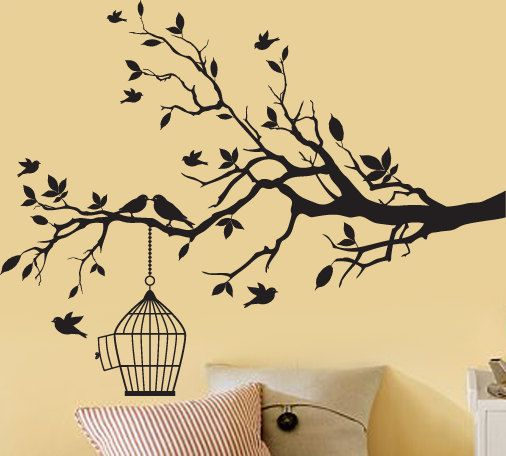 black tree branch wall decal with a bird cage decal and birds vinyl