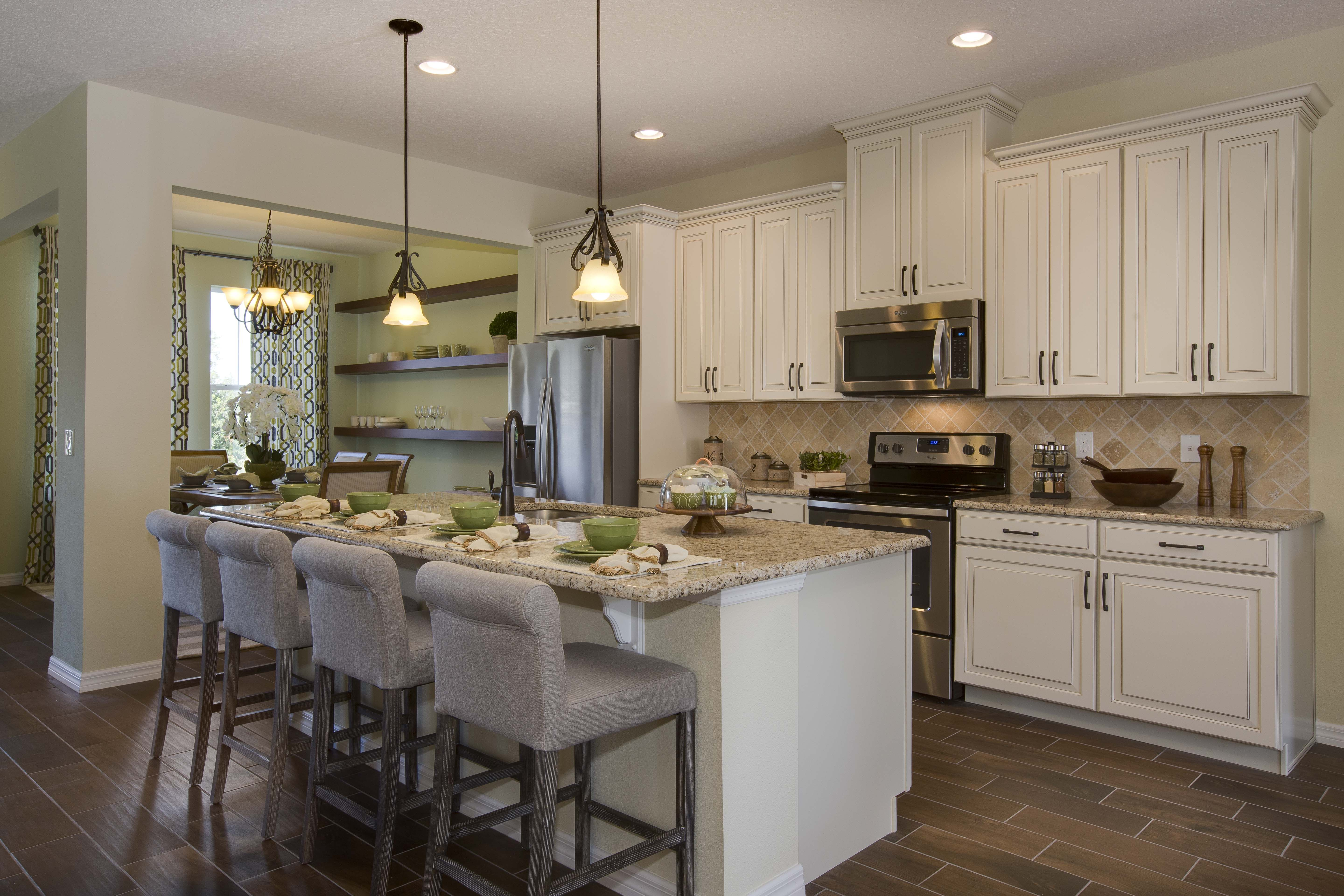 The wood look tile with white kitchen and granite